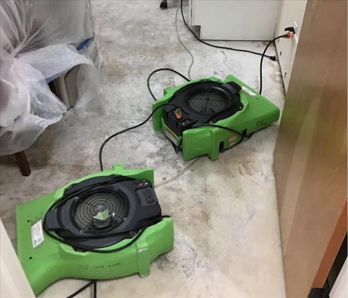 Air movers in a room.
