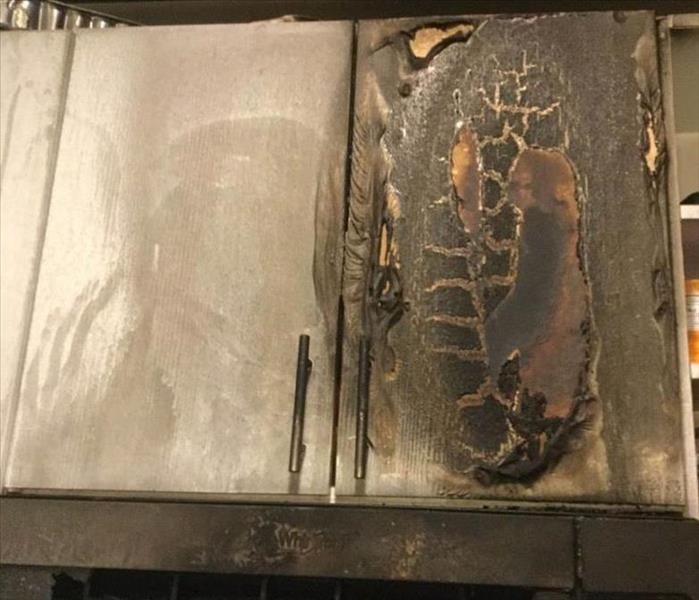 Fire damage on a kitchen cabinet