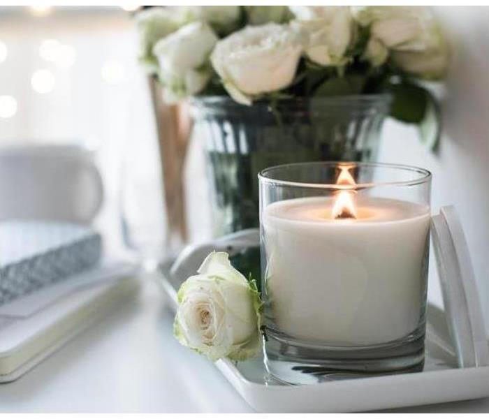 White room interior decor with burning hand-made candle