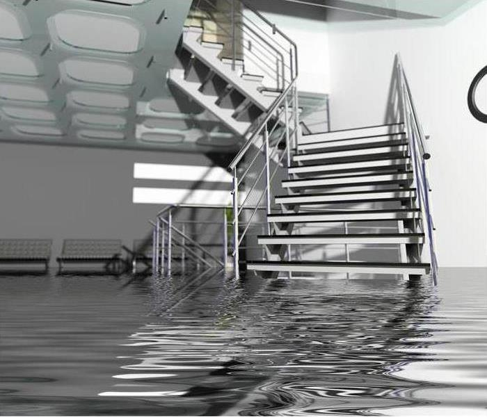 Flooded modern office hall interior with stairs